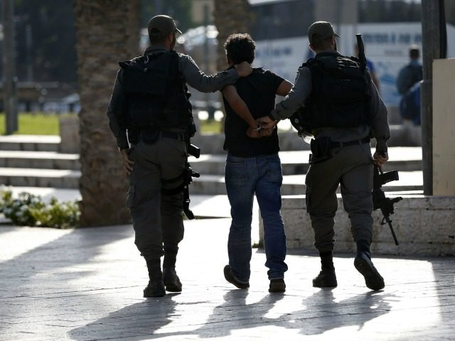 Israeli border policemen arrest a Palestinian protestor, who did not follow their instruction to leave, during a demonstration against administrative detention and in support of Palestinian prisoner Bilal Kayed on August 24, 2016 at Damascus Gate, a main entrance to Jerusalem's Old City. A rights group said on August 24, 2016 Israel's Supreme Court was perpetuating abuses by failing to order that a Palestinian hunger striker shackled to his hospital bed be unchained. Bilal Kayed has been on hunger strike for 71 days in protest against his detention without charge by Israel and is currently chained by the leg to his bed in the intensive care unit of an Israeli hospital. / AFP / AHMAD GHARABLI (Photo credit should read AHMAD GHARABLI/AFP/Getty Images)