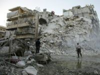 Members of the Syrian Civil Defence, known as the White Helmets, search for victims amid the rubble of a destroyed building following reported air strikes in the rebel-held Qatarji neighbourhood of the northern city of Aleppo, on October 17, 2016. Dozens of civilians were killed as air strikes hammered rebel-held …