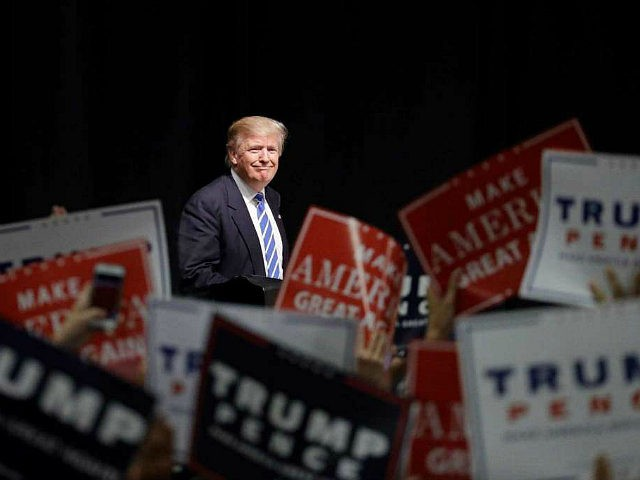 Republican presidential candidate Donald Trump takes the stage at a rally, Wednesday, Sept. 28, 2016, in Council Bluffs, Iowa. (AP Photo/John Locher)