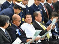 Philippine President Rodrigo Duterte (3rd from L) watches the Japan Coast Guard's training in Yokohama on Oct. 27, 2016. Duterte said he is open to the idea of holding exercises between the defense forces of the two countries. (Photo by Pool/Kyodo News via Getty Images)
