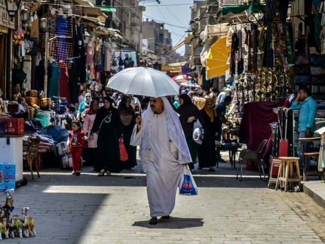 An Egyptian man walks down the street at the Khan al-Khalili market in Cairo on May 20, 2016. The latest EgyptAir plane crash is another crushing blow to a country whose tourism-dependent economy is struggling to recover from years of jihadist attacks and political turmoil, analysts said. / AFP / …
