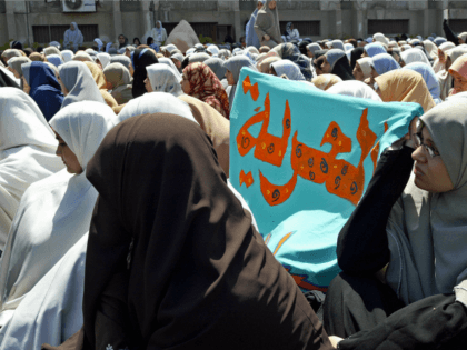 A banner reading in Arabic, 'Freedom' is seen among scores of veiled female students of Islamic al-Azhar University in Cairo 05 March 2005. Scores of al-Azhar students demonstrated inside the compound calling for 'real and democratic' reforms, abrogation of emergency laws installed since 1981 and amendment of the constitution. AFP …