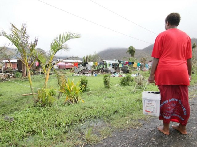 People inspect the damage at Nokonoko settlement on February 26, 2016, caused by Cyclone Winston which devastated Fiji. Humanitarian aid was finally reaching isolated communities in Fiji devastated by super-cyclone Winston, with the government estimating the damage bill will top hundreds of millions of dollars. At least 44 people died …