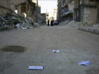 Flyers reportedly distributed by the government encouraging people to leave a rebel-held area in the northern embattled city of Aleppo are seen lying in the street on October 20, 2016. A 'humanitarian pause' in the Syrian army's Russian-backed assault on Aleppo took effect but despite a drop in violence there …