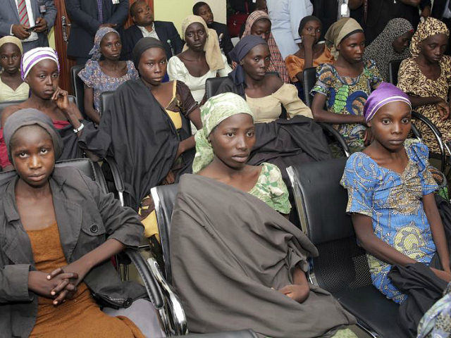 FILE - In this Thursday, Oct. 13, 2016, file photo released by the Nigeria State House, Chibok school girls recently freed from Boko Haram captivity are seen during a meeting with Nigeria's Vice President Yemi Osinbajo, in Abuja, Nigeria. Conflicting reports are emerging Friday about whether the first negotiated release of Chibok schoolgirls kidnapped by Boko Haram in Nigeria in 2014, involved a ransom payment, a prisoner swap for Islamic extremist commanders or both. (Sunday Aghaeze/Nigeria State House via AP, FILE)