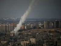 A picture taken from Gaza city shows the smoke that results from the launch of a long-range rocket from the north of the city towards Israel on July 12, 2014 following an advance warning of the attack by Ezzedine al-Qassam Brigades, the military wing of Hamas. Gaza militants fired several …