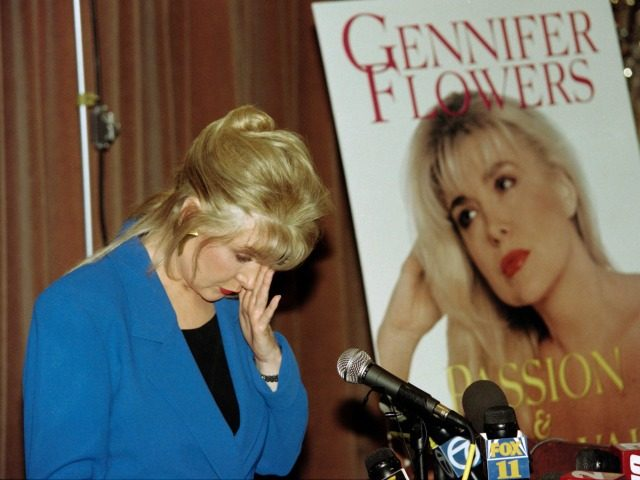Gennifer Flowers, who claims to have carried on a 12-year relationship with US President Bill CLinton, reacts to a question of whether she still loves Bill Clinton during a press conference on April 24, 1995, where she promoted her autobioraphy 'Passion and Betrayal'. The book chronicles her life and her relationship with Clinton. / AFP / Mike NELSON (Photo credit should read MIKE NELSON/AFP/Getty Images)