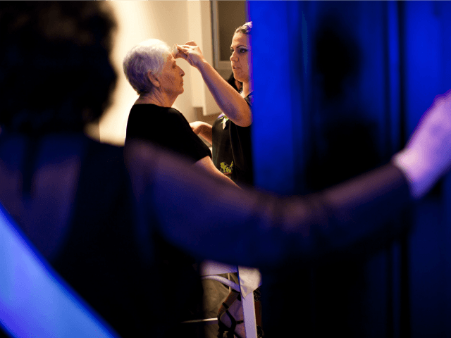 Israeli Holocaust survivor and winner of a Holocaust survivors beauty pageant Chava Hershkovitz, 78, gets her makeup applied ahead of the beauty pageant, on June 28, 2012 in Haifa, Israel. During the pageant, the twenty women competing, between 74 to 90 years of age, shared Holocaust stories witht he audience. …
