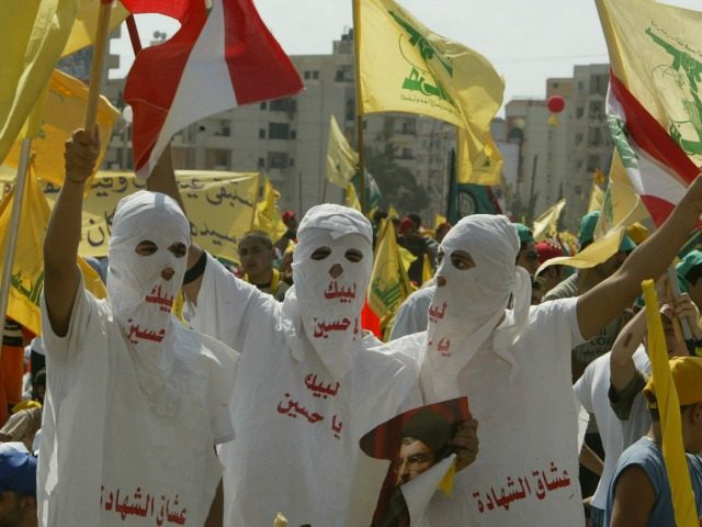 Hezbollah supporters wave flags during a ''Victory over Israel'' rally in Beirut's suburbs on September 22, 2006 in Beirut, Lebanon. Hezbollah leader Sayyed Hassan Nasrallah reportedly said that Hezbollah would not disarm until a Lebanese government capable of protecting the country was in place during the rally. (Photo by Salah …