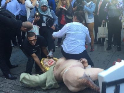 Watch: Naked Hillary Clinton Statue Causes Fight in Manhattan