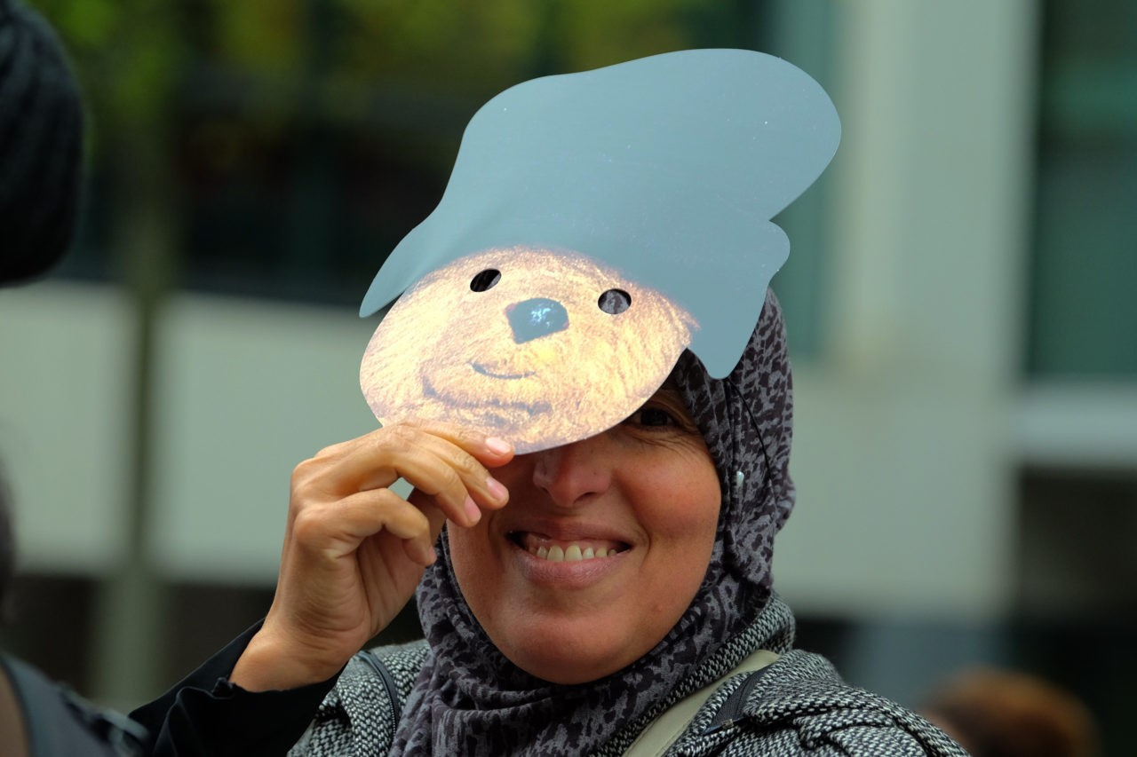 A woman in a hijab wears a Paddington Bear mask (Rachel Megawhat/Breitbart London)