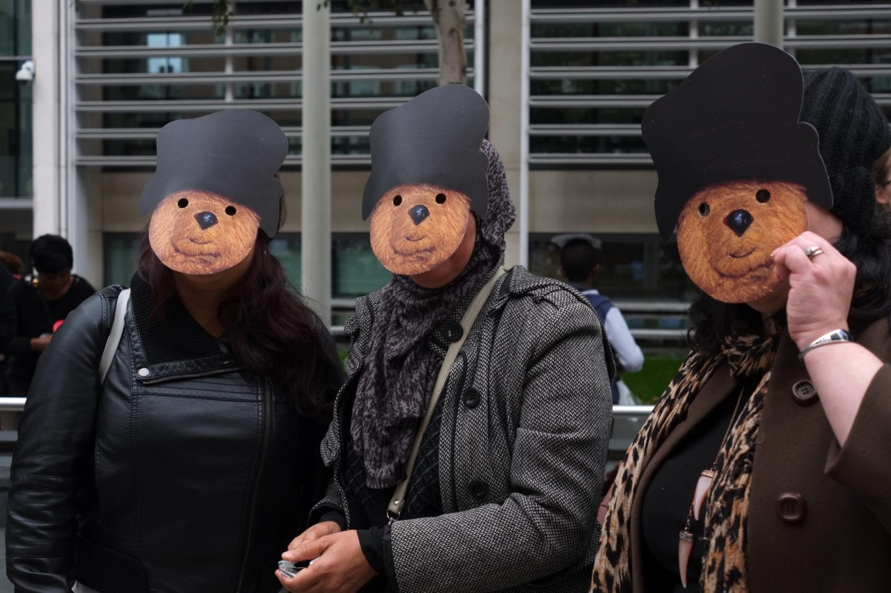 Adult wear Paddington Bear masks at the protest outside the Home Office (Rachel Megawhat/Breitbart London)