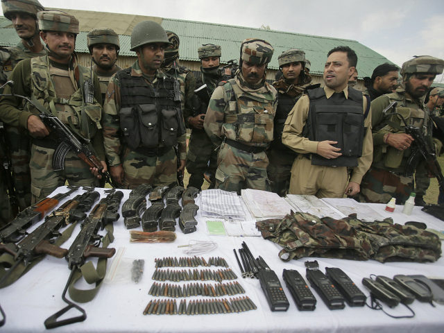 Indian Army soldiers display arms and ammunition recovered with the bodies of suspected militants inside their base camp in Langate 75 kilometers (47 miles) north of Srinagar, Indian controlled Kashmir, India, Thursday, Oct 6, 2016. The Indian army said Thursday that its soldiers foiled an attack on an army camp and killed three suspected rebels in Indian-controlled Kashmir. (AP Photo/Mukhtar Khan)