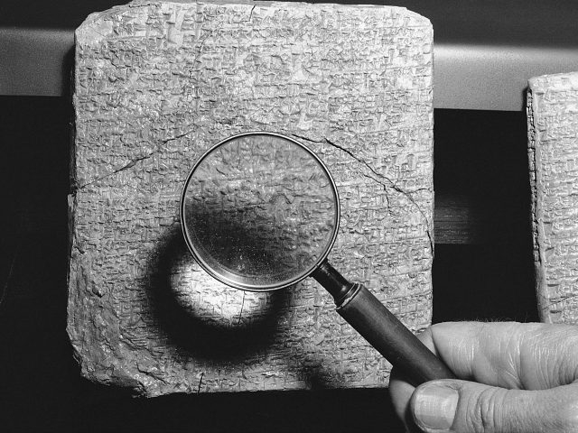 "Here is a close-up view of one of the ancient Sumerian clay tablets upon which cuneiform writings were made more than 3,800 years ago shown Nov. 29, 1952. They were unearthed near Nippur, Iraq, by Donald E. McCown of the University of Chicago during a 1951-52 expedition. This tablet is known as the ""Book of Proverbs."" (AP Photo/Edward Kitch)"
