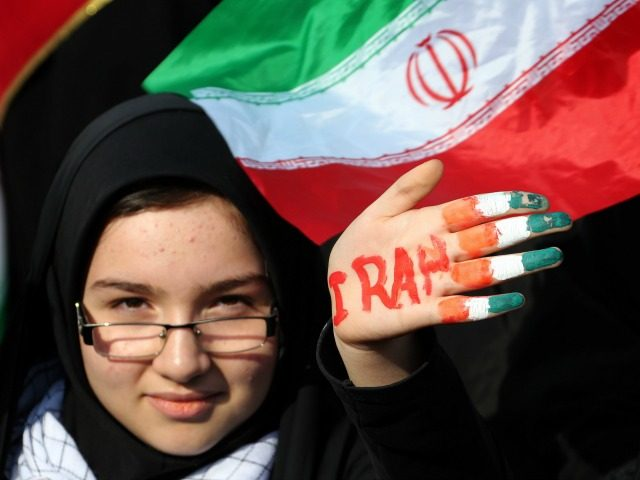 An Iranian female student holds up her hand painted in the colours of her national flag during a rally in Tehran's Azadi Square (Freedom Square) to mark the 35th anniversary of the Islamic revolution on February 11, 2014. The 35th anniversary of the revolution that ousted the US-backed shah, comes …