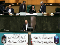 Iranian education minister Ali Asghar Fani (bottom) defends himself during a parliament session to impeach him in Tehran on June 24, 2015. The Iranian educaton minister safely came out of an impeachment session, as the conservative majority threw their weight behind him in an unlikely show of support. AFP PHOTO / BEHROUZ MEHRI (Photo credit should read BEHROUZ MEHRI/AFP/Getty Images)