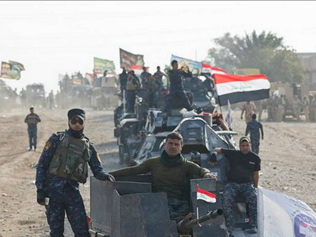 Iraqi Federal Police officers observe as air and ground strikes hit the town of Shura, some 30 kilometers south of Mosul, Iraq, Saturday, Oct. 29, 2016. Iraqi troops approaching Mosul from the south advanced into Shura on Saturday after a wave of US led airstrikes and artillery shelling against Islamic …