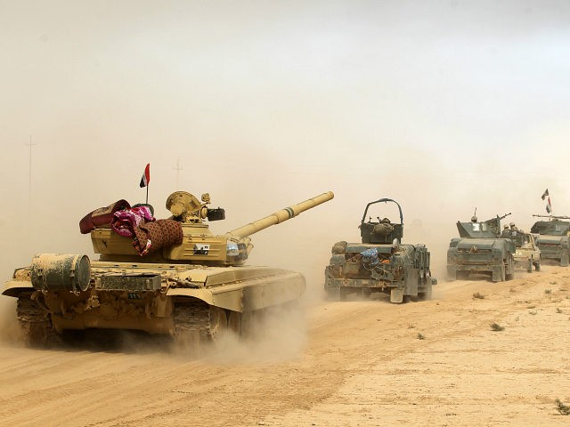 TOPSHOT - Iraqi forces deploy on October 17, 2016 in the area of al-Shurah, some 45 kms south of Mosul, as they advance towards the city to retake it from the Islamic State (IS) group jihadists. Some 30,000 federal forces are leading the offensive, backed by air and ground support from a 60-nation US-led coalition, in what is expected to be a long and difficult assault on IS's last major Iraqi stronghold. / AFP / AHMAD AL-RUBAYE (Photo credit should read AHMAD AL-RUBAYE/AFP/Getty Images)