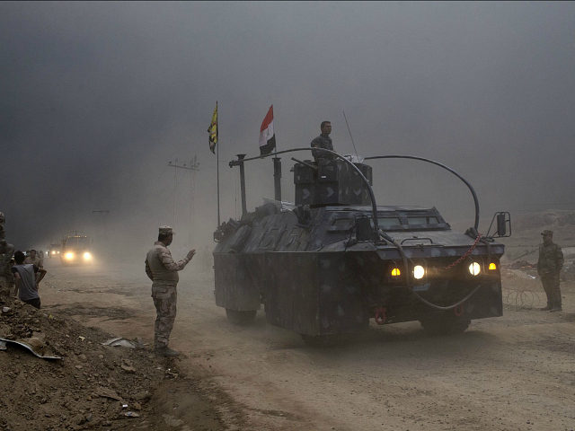 An Iraqi Federal Police vehicle passes through a checkpoint in Qayara, some 50 kilometers south of Mosul, Iraq, Wednesday, Oct. 26, 2016. Islamic State militants have been going door to door in farming communities south of Mosul, ordering people at gunpoint to follow them north into the city and apparently …