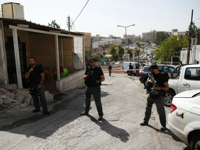 Israeli security forces stand guard at the site of a shooting attack near Israeli police headquarters in mainly Palestinian east Jerusalem on October 9, 2016. A Palestinian opened fire from a car in Jerusalem, wounding four people out of which two have died, before police shot him dead, authorities said. …