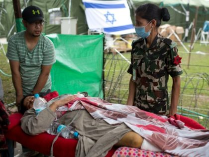 An injured Nepalese woman arrives on stretcher to be treated at the Israeli field hospital in Kathmandu on May 1, 2015, following a 7.8 magnitude earthquake which struck the Himalayan nation on April 25. Desperate survivors living at ground zero of Nepal's earthquake felt abandoned to their fate after losing …