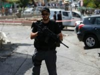 An Israeli security forces member stands guard at the site of a shooting attack near the Israeli police headquarters in mainly Palestinian east Jerusalem on October 9, 2016. A shooting attack in Jerusalem left at least three people wounded, including two seriously, with the assailant killed by police, Israeli authorities …