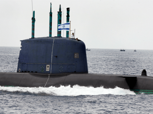 Israeli submarine 'Dolphin' sails along the Mediterranean Sea near the coastal city of Tel Aviv during special naval maneuvers ahead of Israel?s 60th independence anniversary on May 5, 2008. The 'Dolphin', a German-built submarine, is 56.4m long with a cruising range of 4500 nautical miles. It is armed with ten …