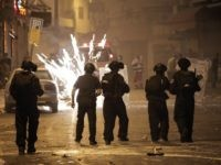 Israeli police throw grenades during clashes with Palestinians in East Jerusalem after the funeral of Palestinian teenager Mohammed Sinokrot, 16, who was wounded by Israeli gunfire on August 31 and died from his injuries on September 8, 2014. News of his death sparked widespread clashes near his home and throughout …