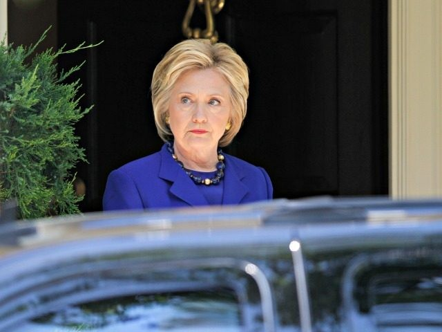 Democratic presidential candidate Hillary Clinton departs her Washington home, Friday, June 10, 2016, after meeting with Sen. Elizabeth Warren, D-Mass. (AP Photo/Paul Holston)