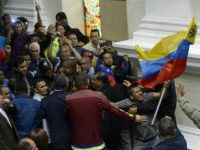 CARACAS, Oct. 23, 2016 : Supporters of the Venezuelan government interrupt a special parliamentary session at the National Assembly in Caracas, Venezuela, on Oct. 23, 2016. Venezuela's political crisis exacerbated on Sunday as the opposition-controlled parliament accused the government of blocking its campaign against President Nicolas Maduro. (Xinhua/Stringer via Getty …