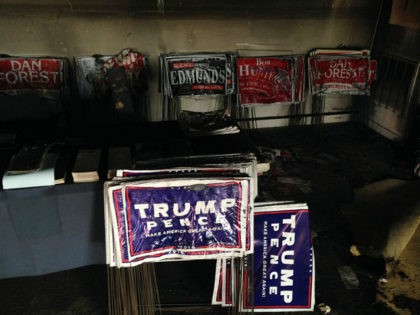 """Melted campaign signs are seen at the Orange County Republican Headquarters in Hillsborough, NC on Sunday, Oct. 16, 2016. Someone threw flammable liquid inside a bottle through a window overnight and someone spray-painted an anti-GOP slogan referring to """"Nazi Republicans"""" on a nearby wall, authorities said Sunday. State GOP director …"""