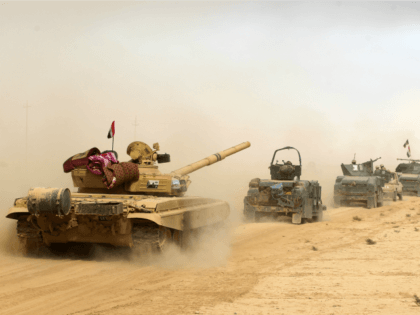 Iraqi forces deploy on October 17, 2016 in the area of al-Shurah, some 45 kms south of Mosul, as they advance towards the city to retake it from the Islamic State (IS) group jihadists. Some 30,000 federal forces are leading the offensive, backed by air and ground support from a …