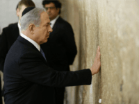 Israeli Prime Minister Benjamin Netanyahu prays on March 18, 2015 at the Wailing Wall in Jerusalem following his party Likud's victory in Israel's general election. Netanyahu swept to a stunning election victory, securing a third straight term for an Israeli leader who has deepened tensions with the Palestinians and infuriated …