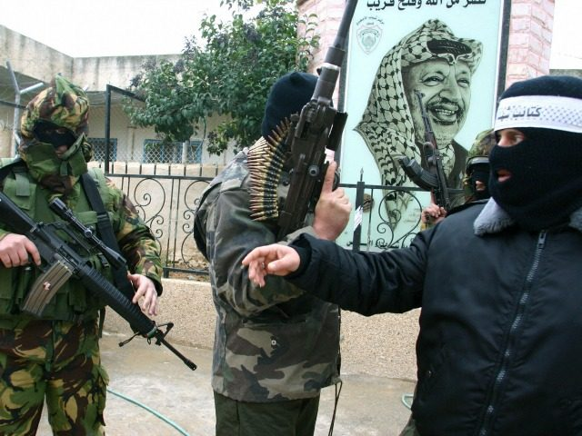 Armed militants from Fatah's Al-Aqsa Martyrs Brigades hold a press conference in the refugee camp of Amaari in the West Bank city of Ramallah, calling the Palestinian Authority to delay the general elections, 26 December 2005. The ruling Fatah faction was given the green light Monday to fuse its list …