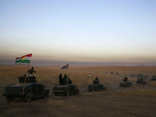 FILE -- In this Monday, Oct. 17, 2016 file photo, Peshmerga convoy drives towards a frontline in Khazer, about 30 kilometers (19 miles) east of Mosul, Iraq. In the week since Iraq launched an operation to retake Mosul from the Islamic State group, its forces have pushed toward the city …