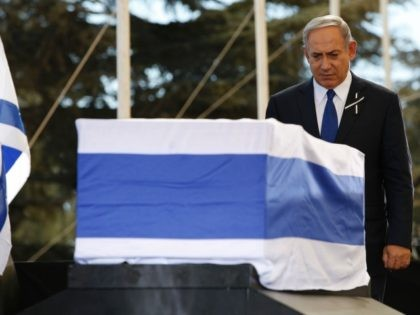 Israeli Prime Minister Benjamin Netanyahu stands before the coffin of former Israeli president Shimon Peres during his funeral on September 30, 2016, at Jerusalem's Mount Herzl national cemetery. Some 70 countries were represented, with the range of leaders illustrating the respect Peres gained over the years in his transformation from …