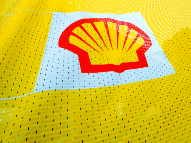 The Shell logo is seen on a flag outside a Shell petrol station in Fleet, Hampshire in southern England on July 29, 2010. British energy giant Royal Dutch Shell said Thursday that net profits jumped 15 percent to 4.393 billion dollars (3.377 billion euros) in the second quarter as it …