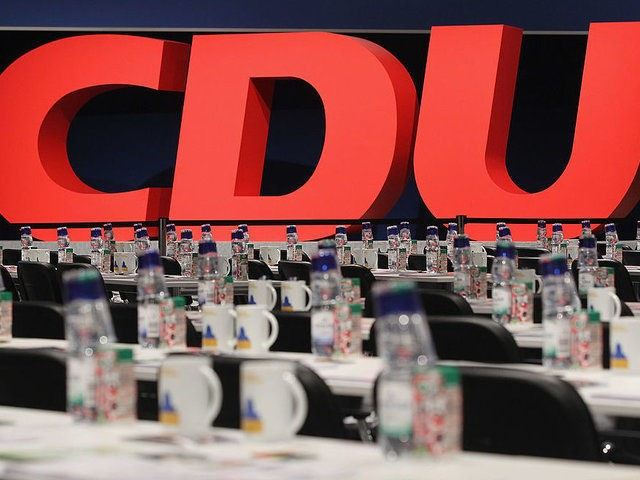 LEIPZIG, GERMANY - NOVEMBER 14: The logo of the German Christian Democrats (CDU) stands behind delegates' tables prior to the opening of the 24th CDU party congress on November 14, 2011 in Leipzig, Germany. The CDU, the senior partner in the current German coalition government, has lost ground among younger …