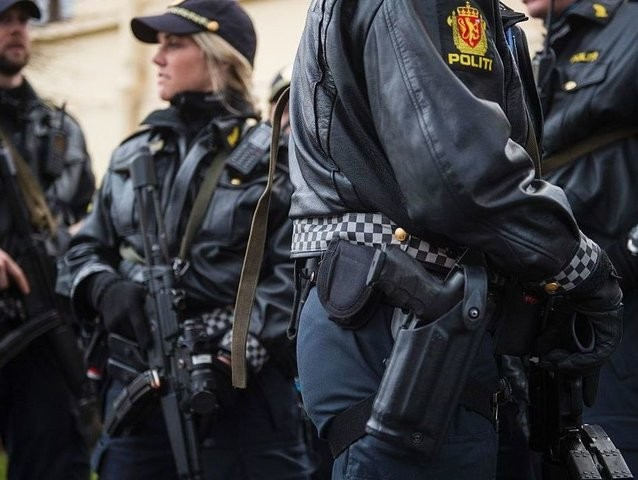 Armed police guard the Nobel institute ahead of a press conference with the Nobel Peace Prize laureates, the Tunisian National Dialogue Quartet in Oslo on December 9, 2015. The normally unarmed Norwegian police force have just announced that they will continue the special measure to carry fire arms for an …