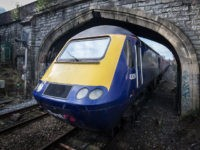 BATH, ENGLAND - FEBRUARY 19: A London Paddington bound train approaches Bath Spa station on the Great Western railway line on February 19, 2016 in Bath, England. The electrification of the route and the replacement of the ageing diesel powered rolling stock, some of which dates back to the nationalised …