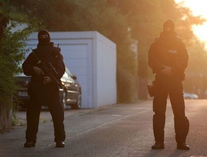 Special police forces block the street near a refugee shelter where a 27-year-old Syrian migrant who set off an explosive device near an open-air music festival have stayed, on July 25, 2016 in Ansbach. A Syrian migrant set off an explosive device near an open-air music festival in southern Germany …