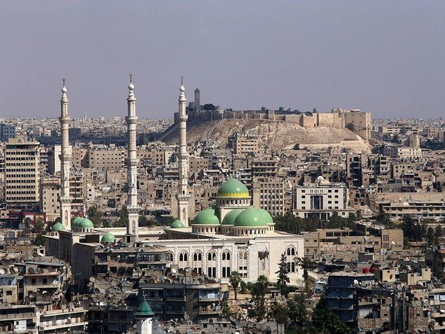 A general view taken on September 15, 2016, shows the UNESCO-listed citadel (C) in the government-controlled side of the divided northern Syrian city of Aleppo. Violence broke out in Aleppo in mid-2012, more than a year after anti-government protests first erupted across Syria. More than five years of war have turned Aleppo's historic city centre, a UNESCO-listed World Heritage site home to an imposing citadel, into a makeshift military barracks. / AFP / Youssef KARWASHAN (Photo credit should read YOUSSEF KARWASHAN/AFP/Getty Images)