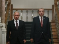 Turkey's President Recep Tayyip Erdogan, right, and Russian President Vladimir Putin arrive for their joint news conference following their meeting in Istanbul, Monday, Oct. 10, 2016. Putin and Erdogan voiced support for the construction of a gas pipeline from Russia to Turkey, called Turkish Stream, a project that was suspended amid tensions between the two countries. The pipeline would carry Russian natural gas to Turkey and onto European Union countries. (AP Photo/Emrah Gurel)