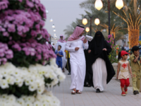 A Saudi family walks past flowers displayed during the Flowers' Festival in Riyadh on April 9, 2008. AFP PHOTO/HASSAN AMMAR (Photo credit should read HASSAN AMMAR/AFP/Getty Images)