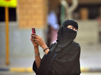 Saudi women take pictures with their mobile phones after the end of a prayer performed on the first day of Eid al-Fitr in the great mosque in the old City of Riyadh, on August 19, 2012 to mark the end of the holy fasting month of Ramadan . Muslims around …