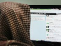 A Saudi man browses through twitter on his desktop in Riyadh, on January 30, 2013. Twitter's unmatched platform for public opinion is emboldening Gulf Arabs to exchange views on delicate issues in the deeply conservative region, despite strict censorship that controls old media. AFP PHOTO/FAYEZ NURELDINE (Photo credit should read …
