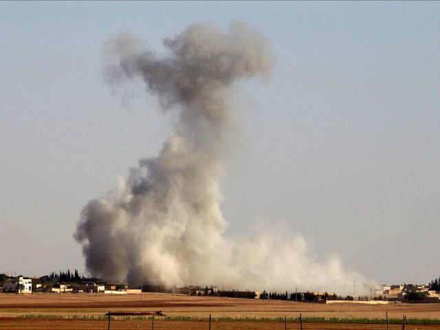 Smoke rises from airstrikes on Guzhe village, northern Aleppo countryside, Syria. REUTERS/Khalil Ashawi