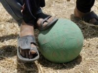 Palestinian children play football in a field east of Gaza City, close to the border fence with Israel, on June 09, 2010. AFP PHOTO/MAHMUD HAMS (Photo credit should read MAHMUD HAMS/AFP/Getty Images)
