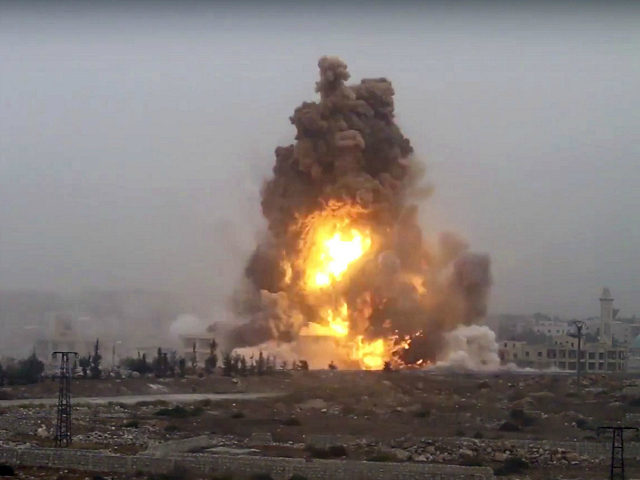 This frame grab from video provided by Thiqa news agency, a Syrian opposition media outlet that is consistent with independent AP reporting, shows flames rises from an explosive vehicle bomb that attacked a Syrian government position, in southwest of Aleppo, Syria, Friday, Oct, 28, 2016. Rebels detonating three vehicle-borne explosives …