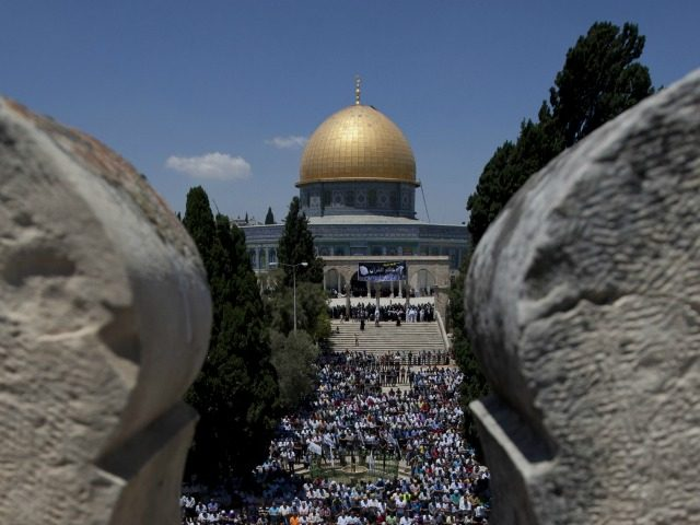 Palestinian worshipers pray outside the Dome of the Rock at the Al-Aqsa Mosque compound in Jerusalem during the third Friday prayers of the Muslim holy fasting month of Ramadan on July 26, 2013. AFP PHOTO/AHMAD GHARABLI (Photo credit should read AHMAD GHARABLI/AFP/Getty Images)